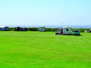 Image of campsite by the sea